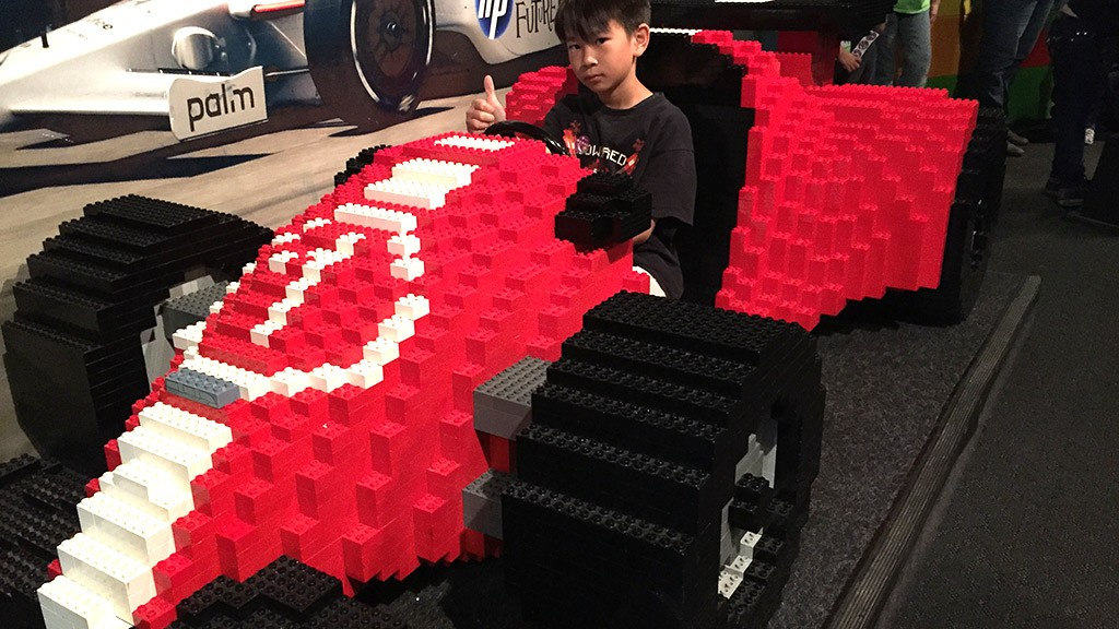 Bored family member in the lego car